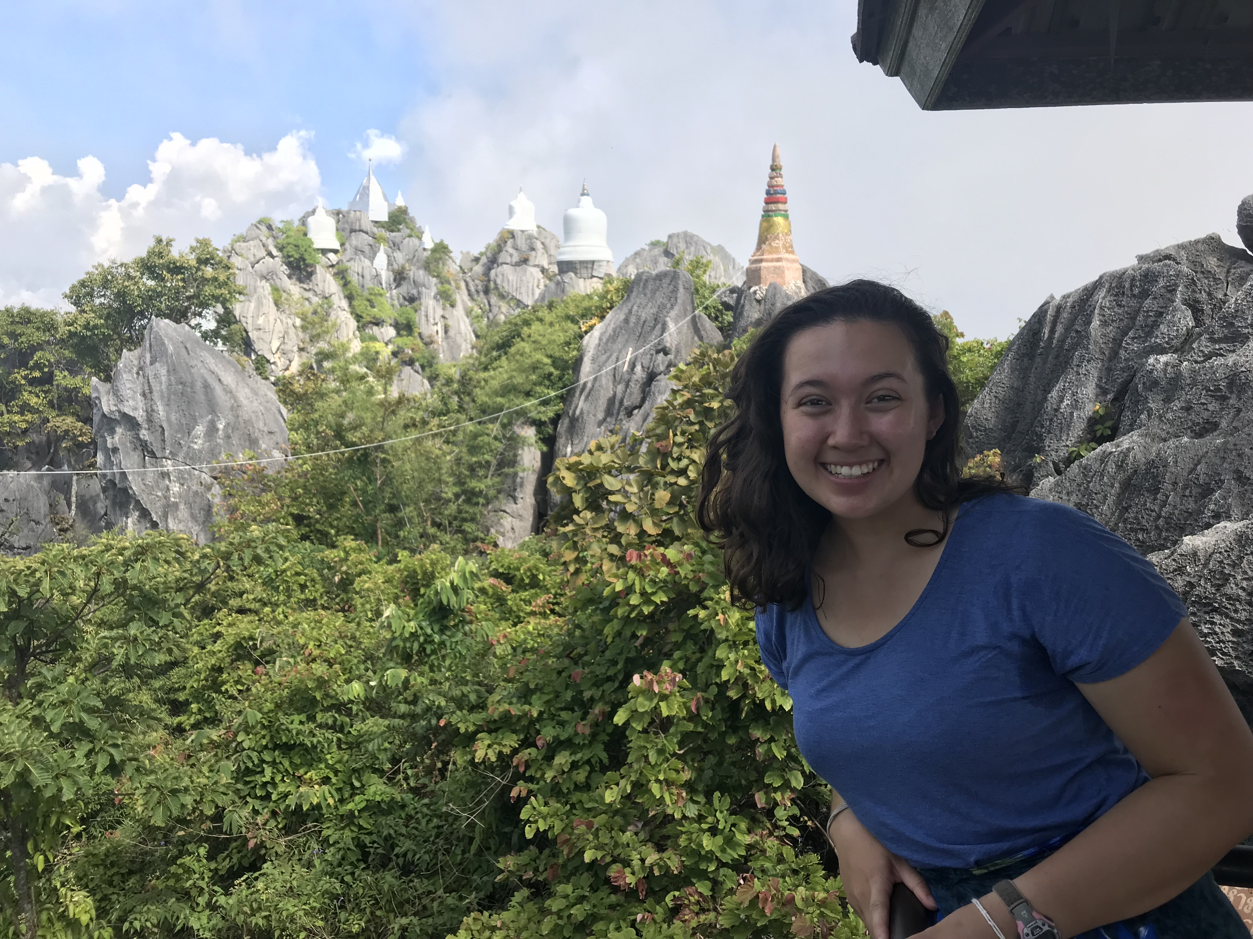 Holly in front of a hilltop temple in Lampang, Thailand